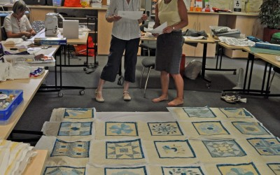Mary H. discussing the layout with Sue