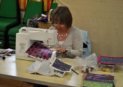 Jane H. working on fabric weaving