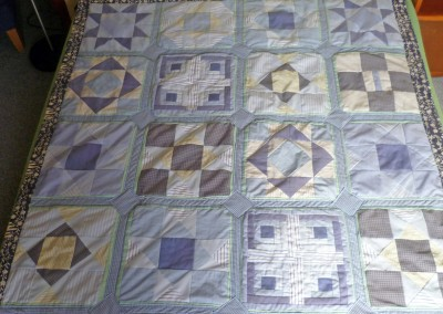 Christine L. completed quilt all made from shirts.