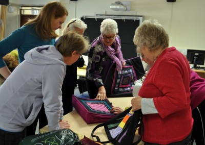 Group photo looking at Malin's bags
