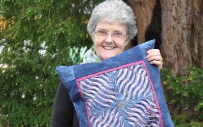 Helen K. Layered & slashed cushion