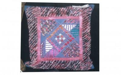 Carole A. Layered & slashed cushion