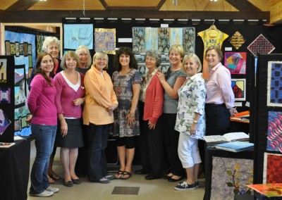 2013 C&G exhibition at Midsomer. L-R some of the students -Nik, Sheila, Barbara F, Catherine, Barbara S, Lynne, Sue, Judy, Julia, Gillian