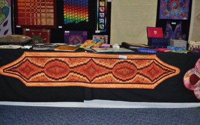 31. Sandy H. A table runner using a Bargello design