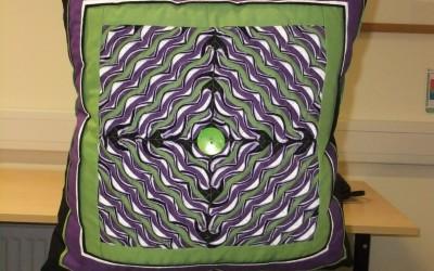 Antje P. slashed cushion