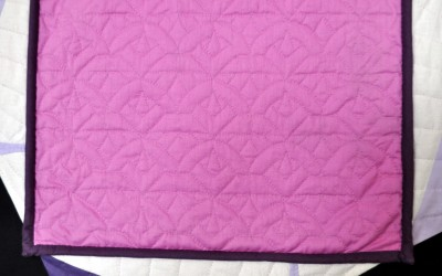 Close up of hand-quilting on back
